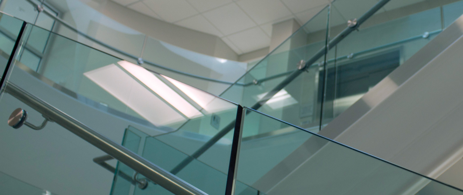 Glass side of staircase inside the hub