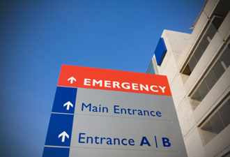 Hospital sign that says Emergency, Main Entrance, and Entrance A B